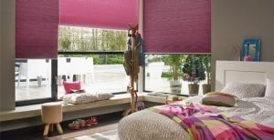 Child's room with hot pink Duette smart blinds operated by alexa