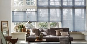Modern living room with large windows fitted with Duette smart blinds for alexa