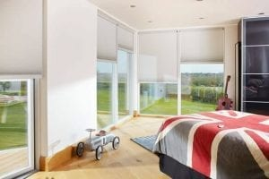 Modern child's bedroom with large windows fitted with Duette energy saving blinds