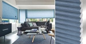 Modern living room with windows fitted with blue Duette recycled blinds