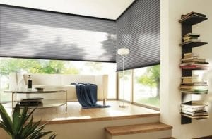 Modern living space with dual aspect windows fitted with Duette recycled blinds