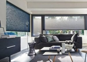Modern living room with windows fitted with Duette recycled fabric blinds