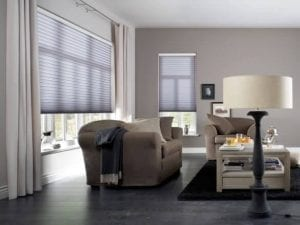Cosy and traditional living space with windows fitted with Duette recycled fabric blinds