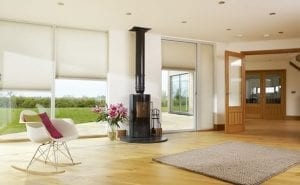 Large open plan living space with bi fold doors fitted with white Duette energy saving blinds