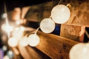 Fairy lights against natural wood