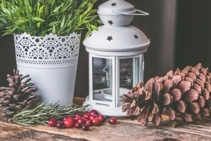 Festive home accessories with pine cones and tealights