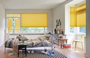 Child's bedroom with yellow Duette energy saving blinds for sustainability