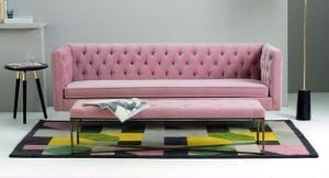 Pink statement sofa in a living room