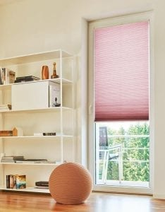 Pink Duette blind brightening up a neutral room decor