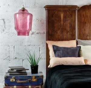 Rustic bedroom decor with statement pink lamp shade