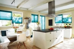 Cosy kitchen and diner with colourful blue Duette energy saving blinds