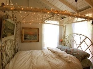Cosy bedroom with fairylights canopy and Duette blinds for light control