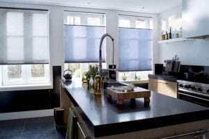 Modern kitchen with blue Duette energy saving blinds