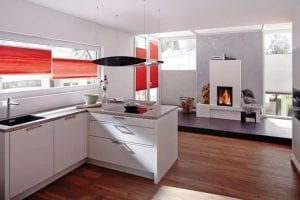 Modern white kitchen living area with statement red Duette energy saving blinds