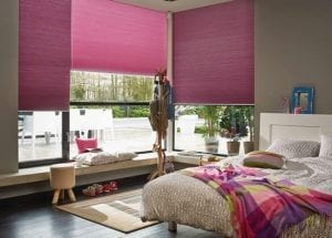 Colourful child's bedrrom with hot pink Duette energy-saving blinds