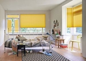 Bedrrom with colourful yellow Duette energy-saving blinds
