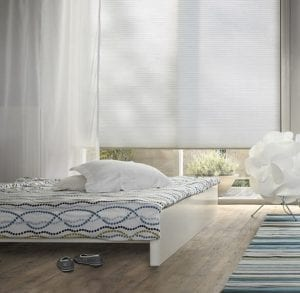 White minimalist bedroom with Duette energy-saving blinds