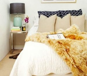 Cosy bedroom with faux fur throw