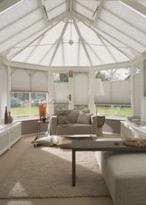 Cosy conservatory fitted with Duette blinds